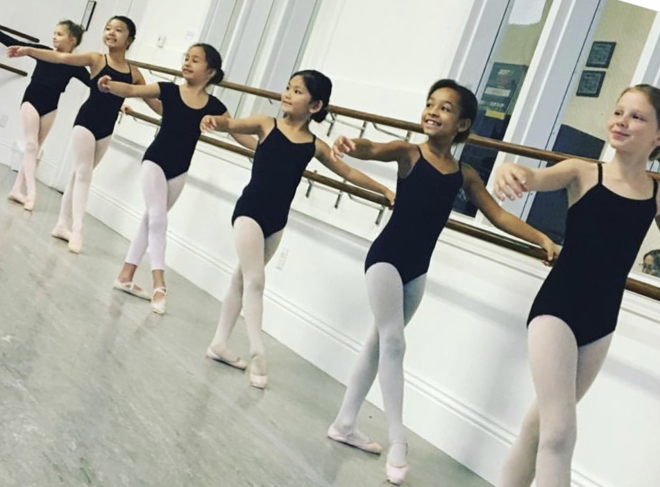 Dancers at the ballet barre.